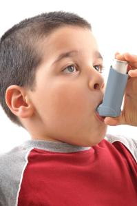kid with asthma inhaler